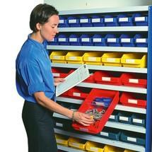 Bloqueio de extração para caixas para estanteria
