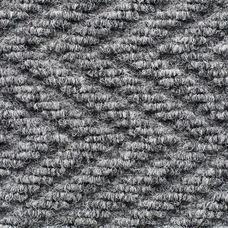 Dust control mat with herringbone pattern