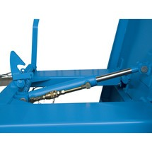 Náklopná brzda pro sklápěcí nádrž, nízká konstrukční výška