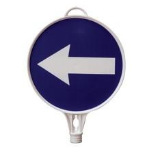 Tabliczka informacyjna, strzałka wskazująca kierunek, w lewą stronę, kształt okrągły